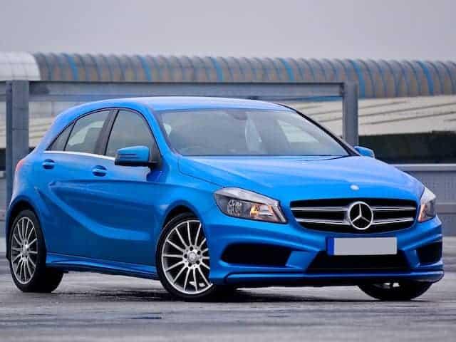 A blue Mercedes hatchbacck.